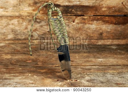 Hunting knife on wooden background