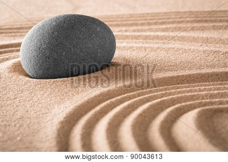 japanese zen garden stone and lines in sand