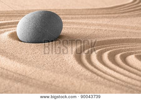 zen meditation stone background in Japanese sand garden. Spa and wellness stones treatment,