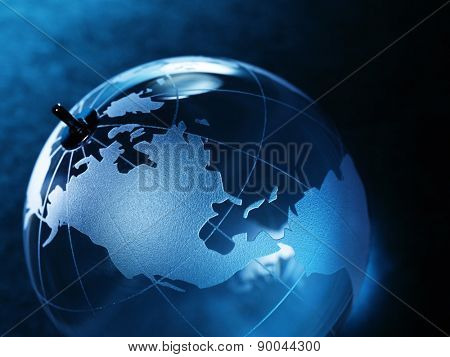 glass ball with a picture of a world map on vintage paper background