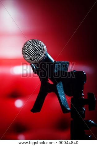 Close Up Texture Of Microphone In Music Hall Against Red Luxury Background