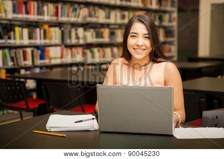 Pretty Girl Using A Laptop Computer