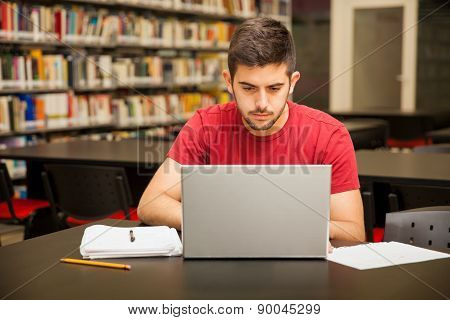 Busy Student Using A Laptop