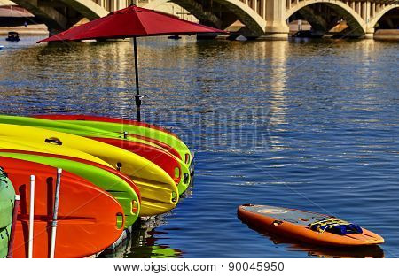 Kayaks Stacked On Dock In Water