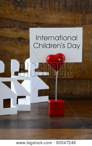 International Childrens Day Concept With Paper Dolls.