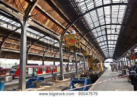 Workers Repare The More Than 100 Years Old Roof Of Classicistical Train Station In Wiesbaden
