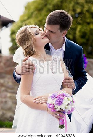Handsome Groom Giving A Kiss On Brides Cheek