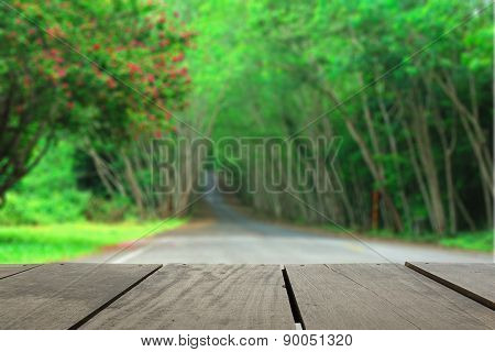 Defocus And Blur Image Of Terrace Wood And Tree Tunnel For Backg