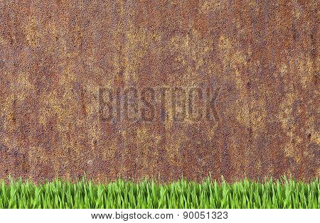 Rusty Wall And Green Grass Background