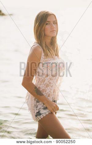 Portrait Of Dreamy Fashion Woman In Sea Water