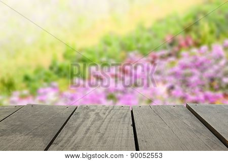 Defocused And Blur Image Of Terrace Wood And Beautiful Violet Fo