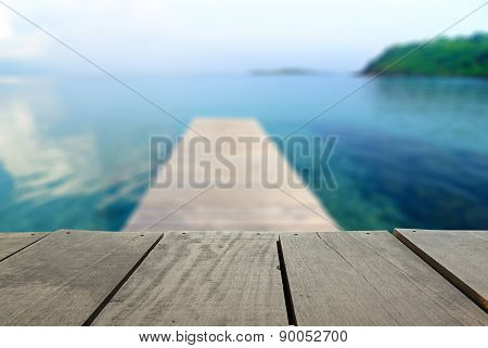 Defocused And Blur Image Of Terrace Wood And Jetty Walkway Into