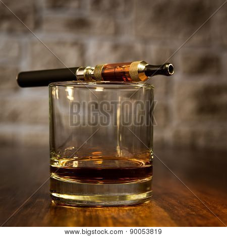 Electronic Cigarette And A Glass Of Bourbon