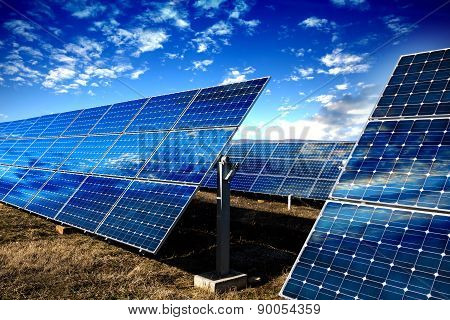 Solar Panels And Cloudy Sky