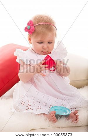 Pretty Girl Playing With Cup Toy