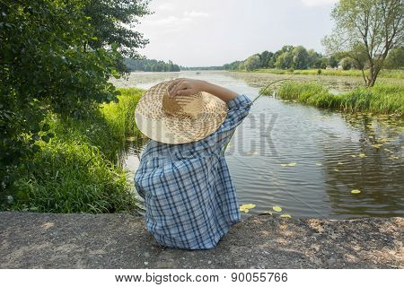 Angling Boy With Fishing Rod Holding With One Hand Straw Hat