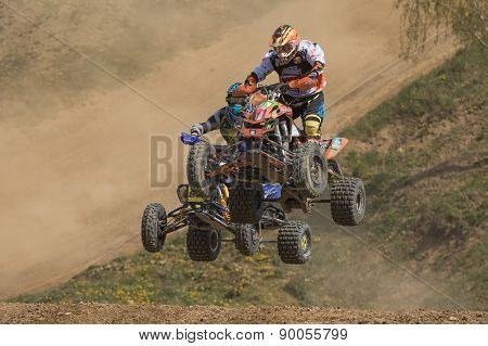 Two Quad Riders Are Jumping Over The Horizon