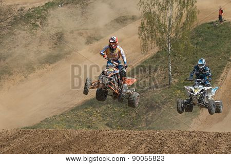 Two Quad Riders In A Jump In The Race