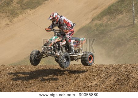 Racer Is Jumping A Quad Bike
