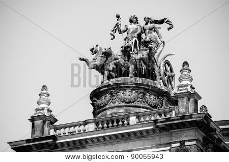 Statue on roof of historical building in center of Dresden, the capital of the German state of Saxony