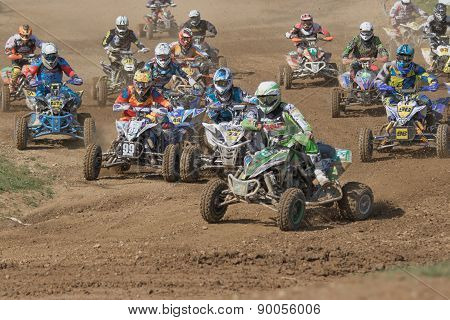 Quad Riders Are Entering The First Turn After The Start