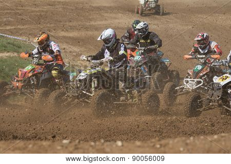 Closeup Of Quad Riders In Turn After The Start