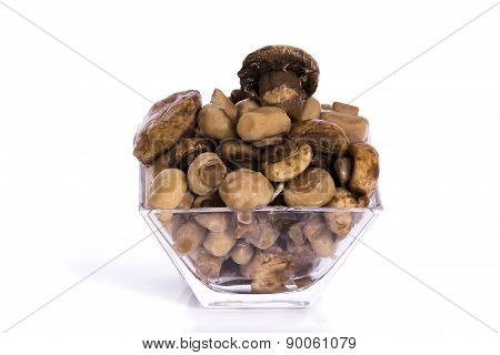 Marinated mushrooms in glass