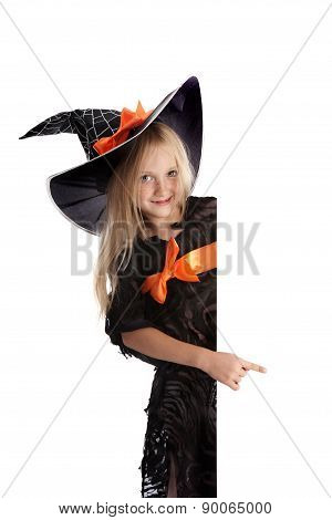 Little Playful Witch Holding A Sign