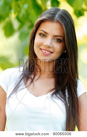 Portrait of young beautiful woman outdoors