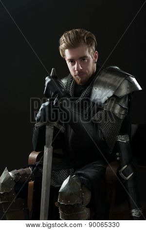 Portrait of ancient knight in metal armor