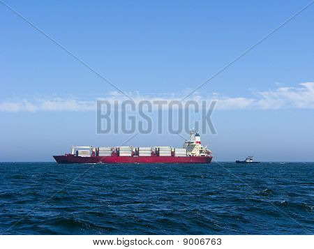 Container Ship And Tug Boat