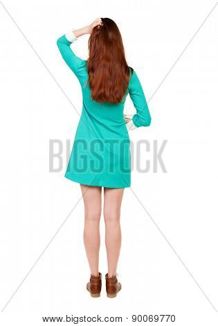 back view of standing young beautiful  woman. girl  watching. Rear view people collection.  backside view person. Isolated over white background. girl in a short dress thoughtfully scratching his head