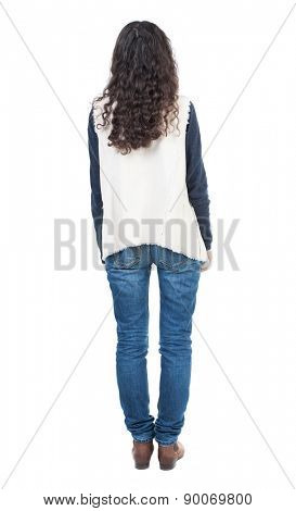 back view of standing young beautiful  woman.  girl  watching. Rear view people collection.  backside view of person.  Isolated over white background. Curly girl in a white tank top is worth it.