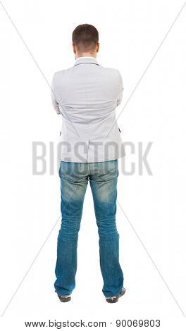back view of Business man  looks.  Rear view people collection.  backside view of person.  Isolated over white background. A guy in a white jacket folded his arms across his chest.