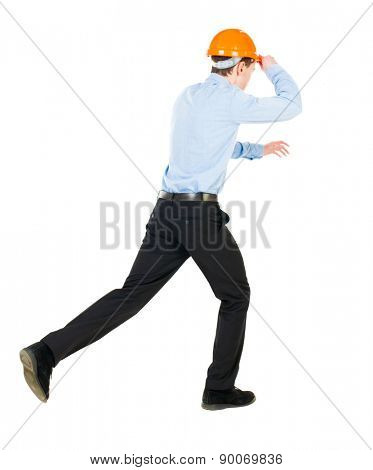 Back view of running engineer in helmet. Walking guy in motion. Rear view people collection. Backside view person. Isolated over white background. Holding helmet visor for an engineer to run the event