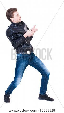 back view of standing man pulling a rope from top or cling to something.  Rear view people collection.  backside view of person.  Isolated over white background. curly-haired man pulls rope fictional.
