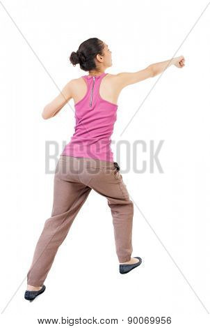 skinny woman funny fights waving his arms and legs. Rear view people collection.  backside view of person.  Isolated over white background. African-American woman punches