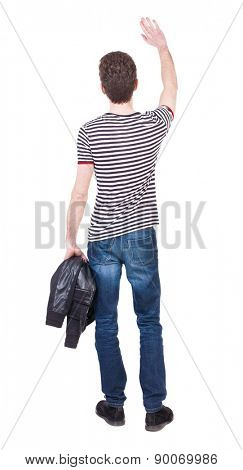 Back view of beautiful man welcomes. man hand waving from. Rear view  people collection.  backside view of person.  Isolated over white background. Man holding a jacket in his left hand.