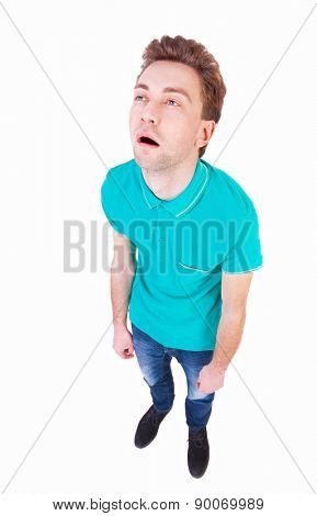Top view of a bored man. tired man looking up. Isolated over white background. Bored guy. wide-angle lens.