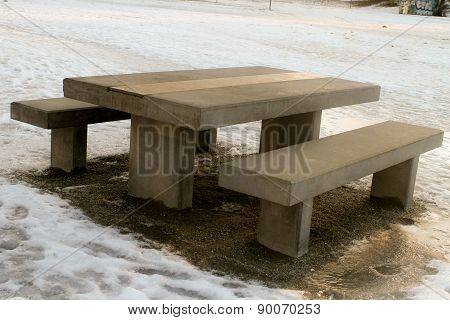 Benches and seats in the park in winter