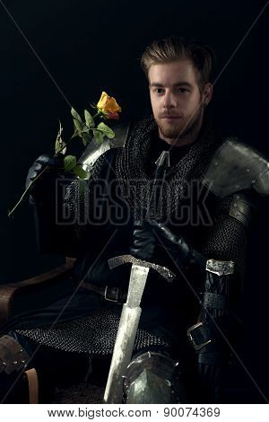 portrait of ancient knight with yellow rose