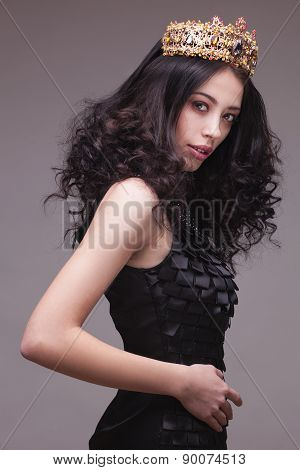 Fashion shot of a woman with diadem in black dress