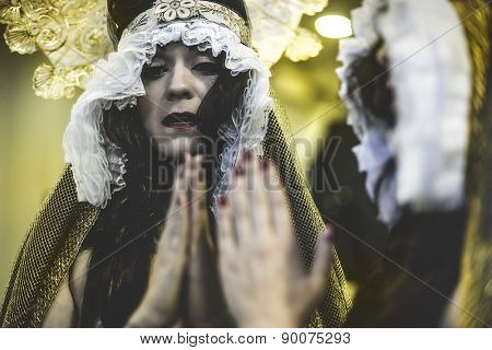 Tears, concept virgin, religion, woman with white headdress and gold crown