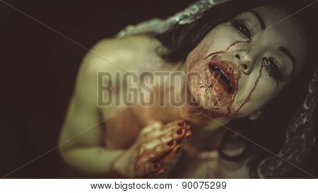 naked woman with blood on her face