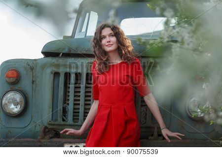Long-haired Brunette Girl In Venetian Red Dress During Springtime Vintage Travel