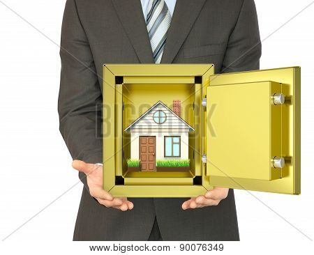 Man holding house in safe