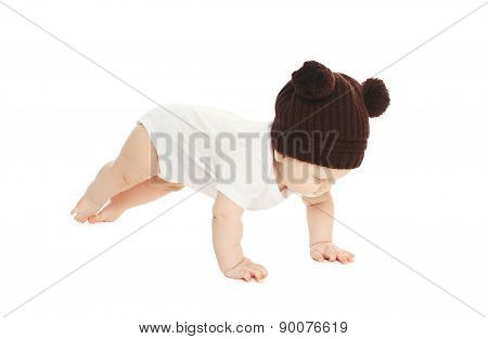 Baby In Knitted Hat On A White Background