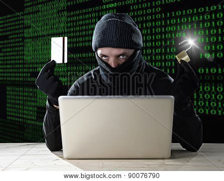 Man In Black Holding Credit Card And Lock Using Computer Laptop For Criminal Activity Hacking Bank A