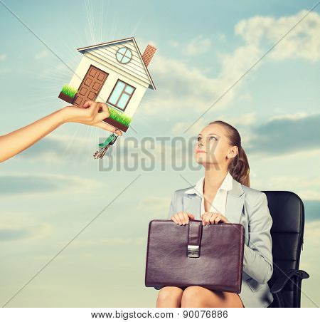 Businesswoman sitting in the chair looking up