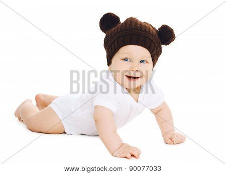 Portrait Of Smiling Sweet Baby In Brown Knitted Hat With Ears Bear